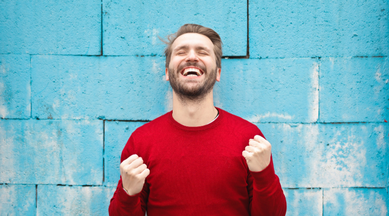 A man laughing and smiling